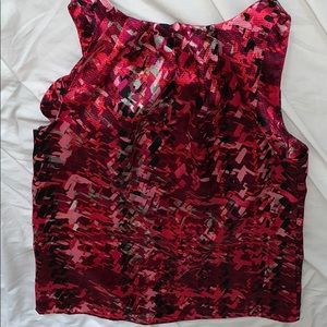 The limited sleeveless blouse multi color small